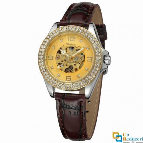 Set ceas barbatesc si dama Winner, carcasa din aliaj de culoare galbena, curea din piele neagra, mecanism automatic-mecanic, rezistent la zgarieturi
